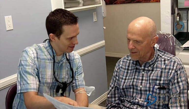 Dr. David Herbert with patient explaining the procedure